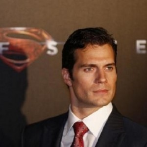"Cast member Cavill poses for pictures after his arrival to the Australian premiere of ""Man of Steel"" in central Sydney"