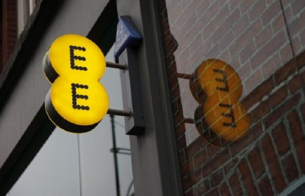 A sign is seen outside an EE shop on Oxford Street in London
